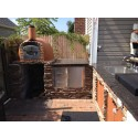 Brick pizza oven in Backyard